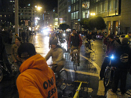 Tail end turns on Powell from Geary as the traditional loop around Union Square commences. San Francisco, Critical Mass, January 29, 2010.